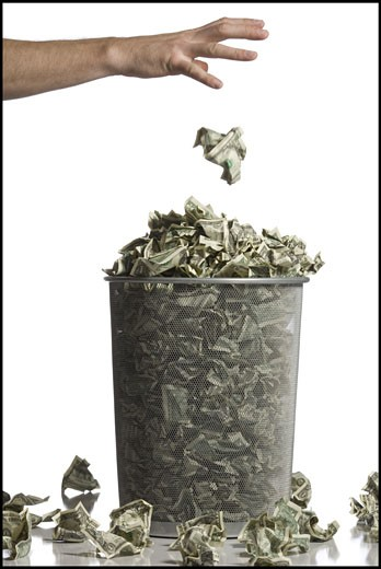 Stock Photo: 1660R-19689 Person throwing crumpled money into waste paper basket