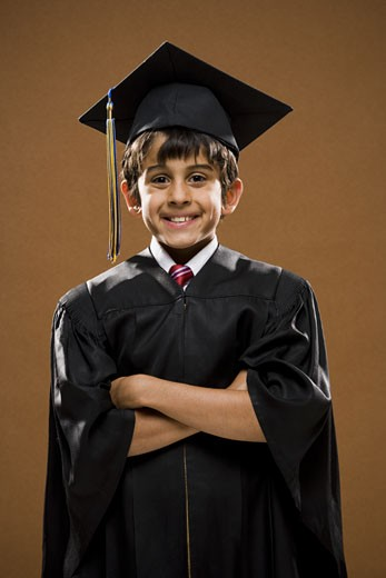 Stock Photo: 1660R-19742 Boy graduate with mortar board smiling with arms crossed