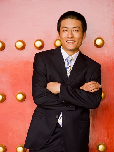 Stock Photo: 1660R-20391 Portrait of a businessman with arms crossed smiling