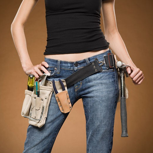 Stock Photo: 1660R-20563 Mid section view of woman with tool belt