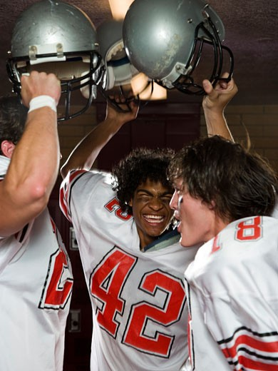 Two High School football players. : Stock Photo