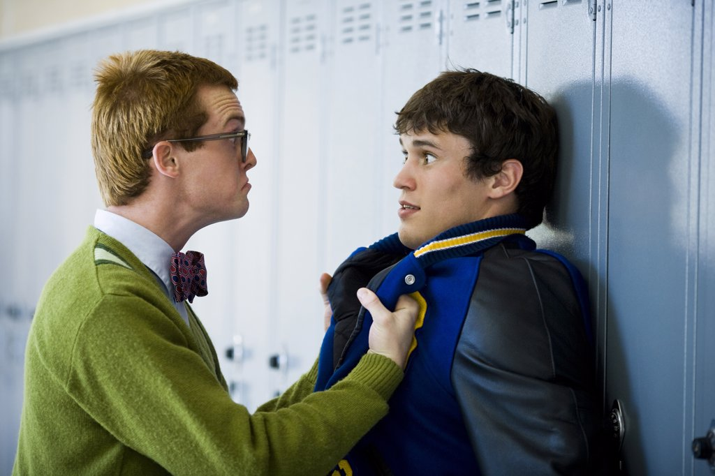 Nerd picking on jock. : Stock Photo