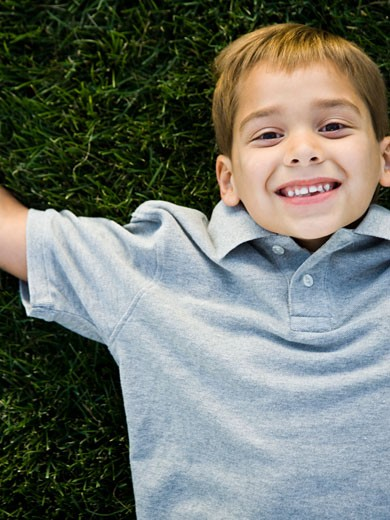 boy lying on the grass. : Stock Photo