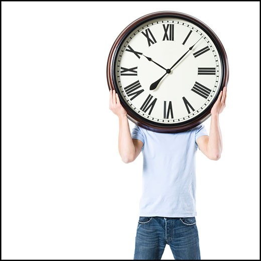 young man with a clock : Stock Photo