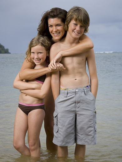 Stock Photo: 1660R-24513 Portrait of a mother embracing her two children