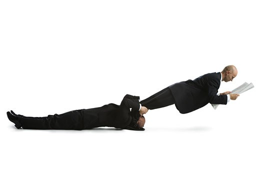 Stock Photo: 1660R-24607 Profile of two male acrobats in business suits