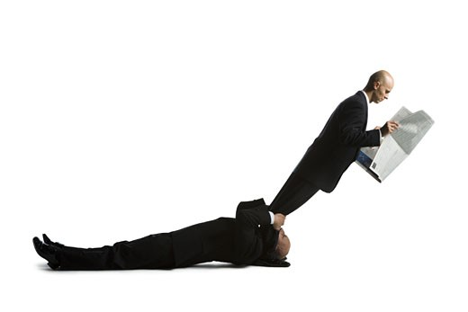 Stock Photo: 1660R-24608 Profile of two male acrobats in business suits