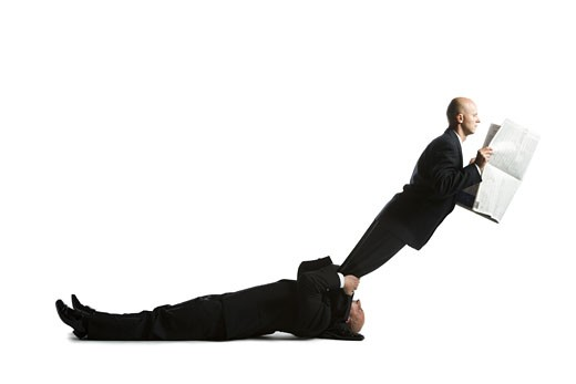 Stock Photo: 1660R-24609 Profile of two male acrobats in business suits
