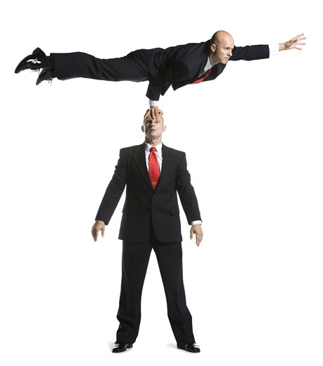 Stock Photo: 1660R-24615 Two male acrobats in business suits performing