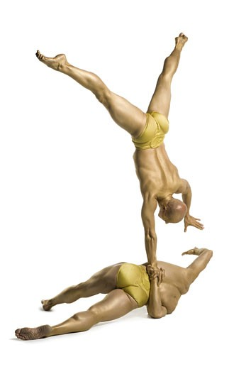 Stock Photo: 1660R-24624 Two male acrobats performing