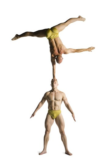 Stock Photo: 1660R-24625 Two male acrobats performing
