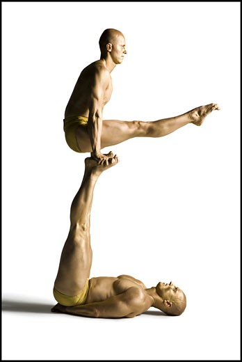 Stock Photo: 1660R-24630 Two male acrobats performing
