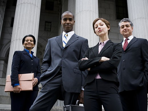Stock Photo: 1660R-24789 Low angle view of lawyers in front of a courthouse