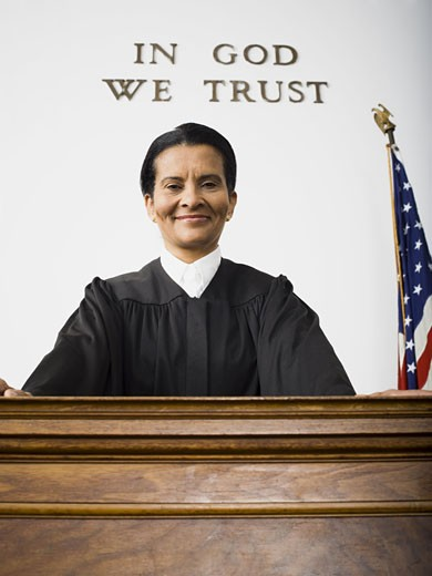 Portrait of a female judge smiling : Stock Photo