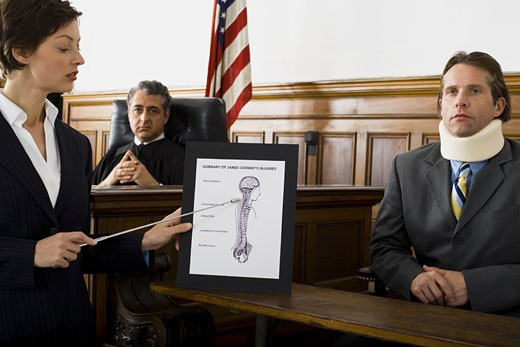 Stock Photo: 1660R-24800 Female lawyer pointing at an exhibit in front of a judge and a victim