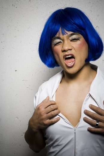 Stock Photo: 1660R-25053 Man in blue wig and makeup flirting