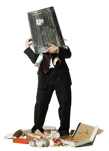 Stock Photo: 1660R-25094 Businessman with trash can on head