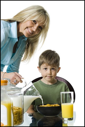 Portrait of a mother and her son at the breakfast table : Stock Photo