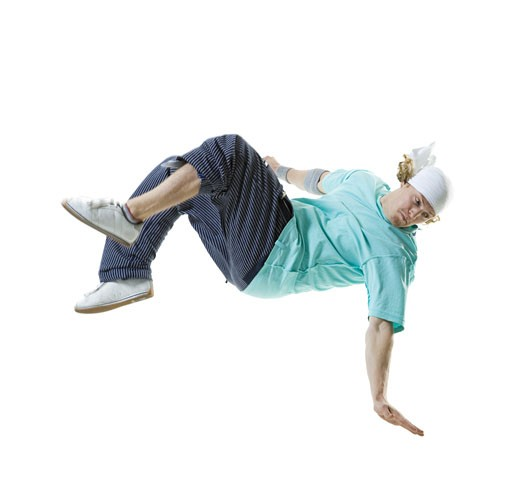 Stock Photo: 1660R-26476 Profile of a young man break dancing