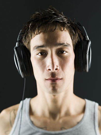 Stock Photo: 1660R-26501 Close-up of a young man with headphones on