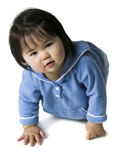 Stock Photo: 1660R-2655 Portrait of a baby girl crawling