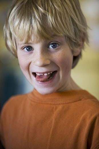 Stock Photo: 1660R-2668 Portrait of a boy sticking out his tongue