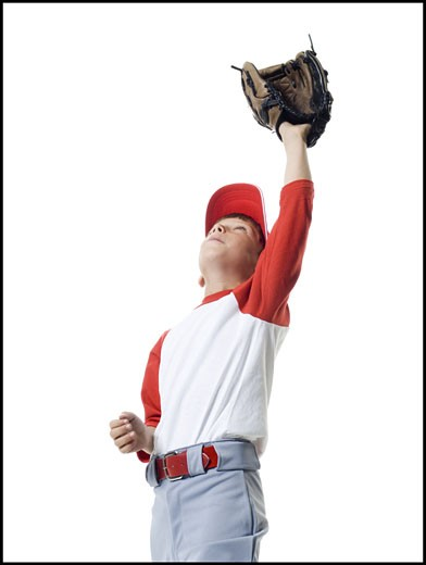 Close-up of a baseball player catching a baseball : Stock Photo