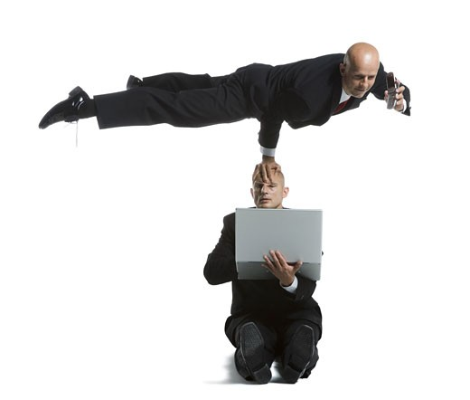 Stock Photo: 1660R-26715 Two male acrobats in business suits performing