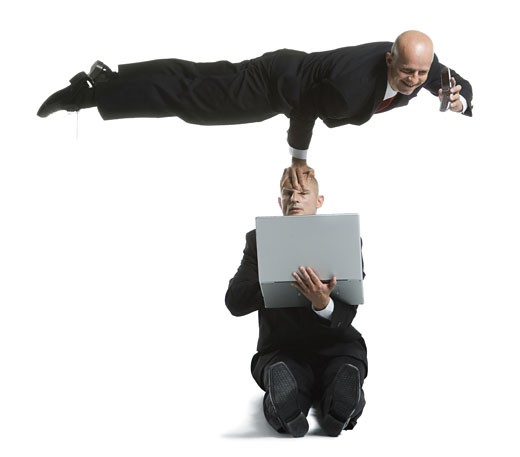 Stock Photo: 1660R-26716 Two male acrobats in business suits performing