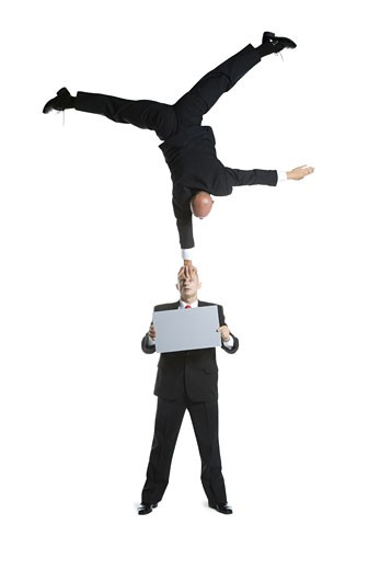 Stock Photo: 1660R-26718 Two male acrobats in business suits performing