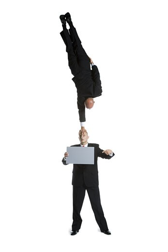 Stock Photo: 1660R-26721 Two male acrobats in business suits performing