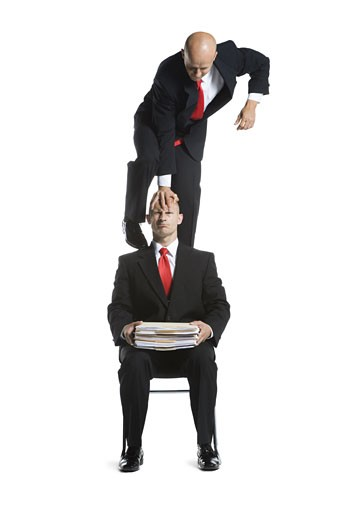 Stock Photo: 1660R-26723 Two male acrobats in business suits performing