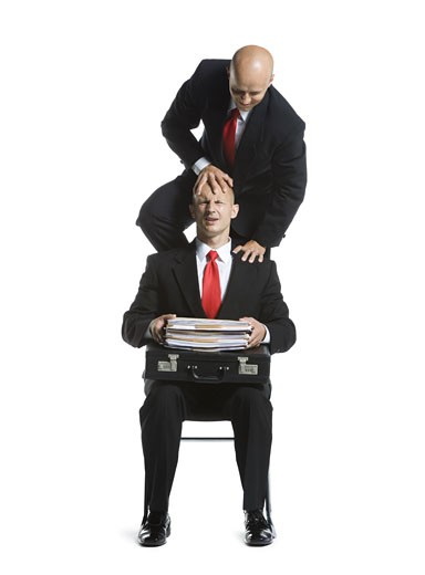 Stock Photo: 1660R-26725 Two male acrobats in business suits performing