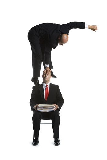 Stock Photo: 1660R-26726 Two male acrobats in business suits performing