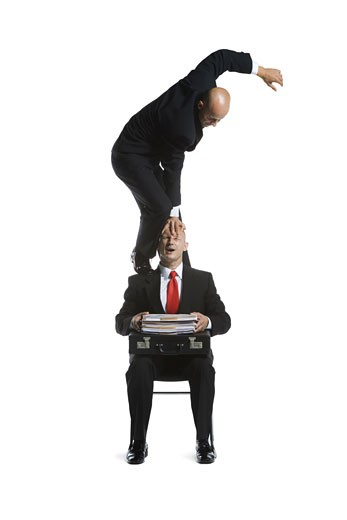 Stock Photo: 1660R-26727 Two male acrobats in business suits performing