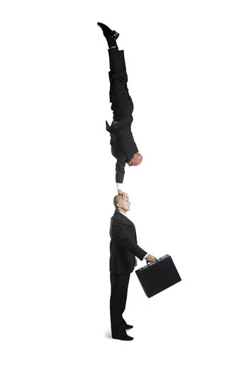 Stock Photo: 1660R-26728 Profile of two male acrobats in business suits performing