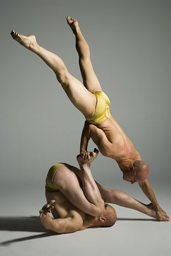 Stock Photo: 1660R-26740 Two male acrobats performing