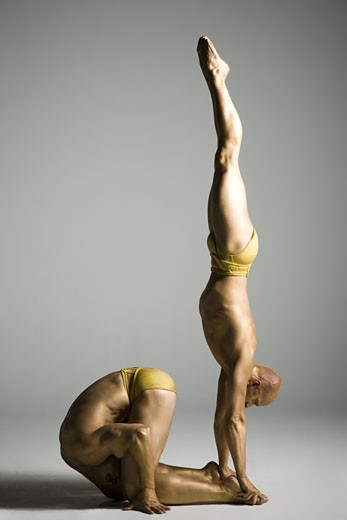 Stock Photo: 1660R-26748 Two male acrobats performing