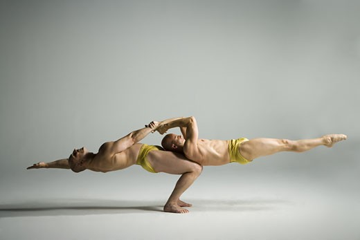Two male acrobats performing : Stock Photo