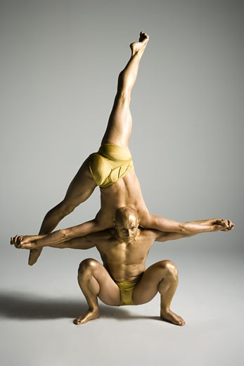 Stock Photo: 1660R-26762 Two male acrobats performing