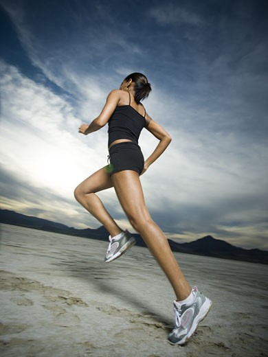 Stock Photo: 1660R-26779 Low angle view of a young woman jogging
