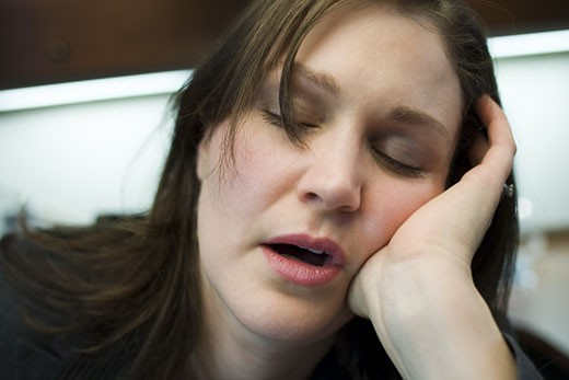 Stock Photo: 1660R-26821 Close-up of a mid adult woman sleeping with her head in her hands
