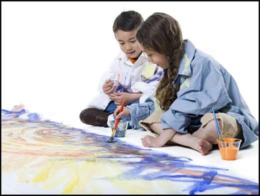Stock Photo: 1660R-26857 Girl and her brother painting on the floor