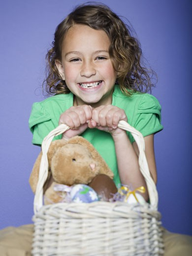 Stock Photo: 1660R-27041 Portrait of a girl holding Easter eggs in a wicker basket