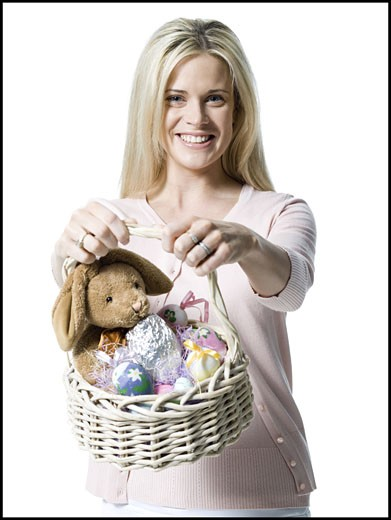Stock Photo: 1660R-27085 Portrait of a young woman holding a teddy bear in a wicker basket