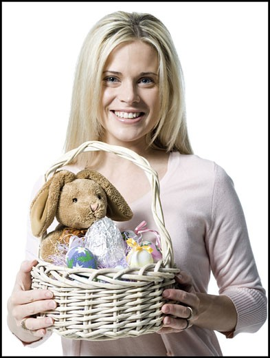 Stock Photo: 1660R-27086 Portrait of a young woman holding a teddy bear in a wicker basket