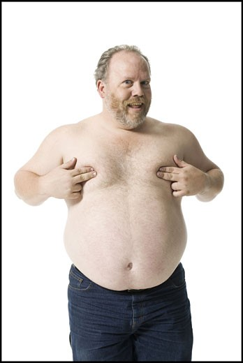 Portrait of a mature man covering his chest with his hands : Stock Photo