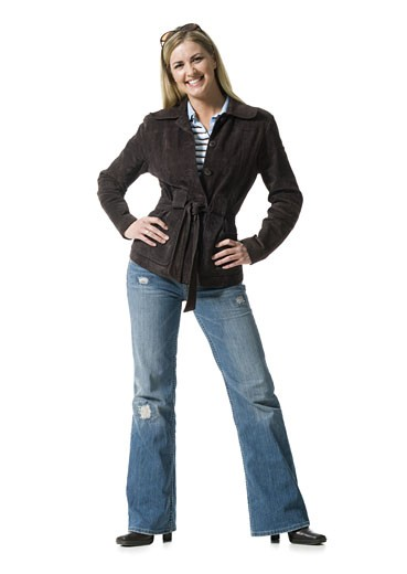 Portrait of a mid adult woman with her hands on her hips : Stock Photo