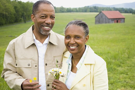 Portrait of a senior man and a senior woman smiling : Stock Photo