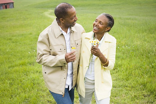 Stock Photo: 1660R-27229 Close-up of a senior man and a senior woman smiling